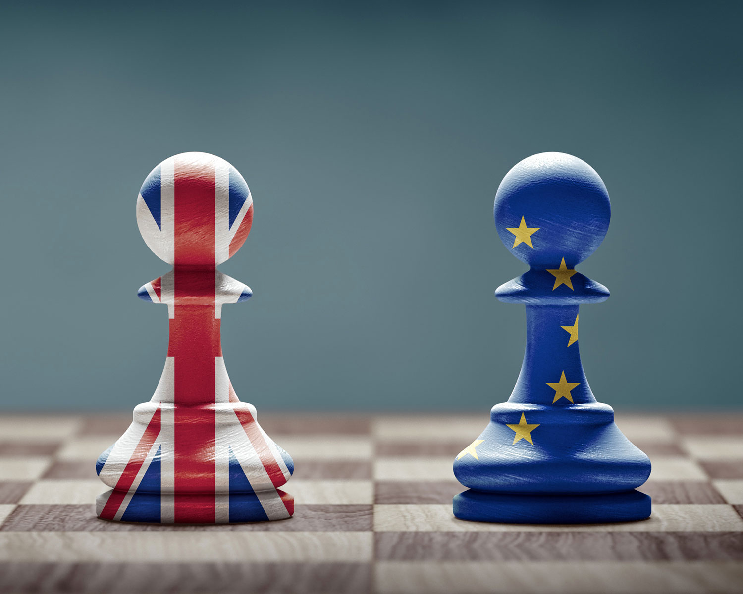 EU UK trade talks impact on exchange rate. Brexit concept. United Kingdom and European Union flags on chess pawns.
