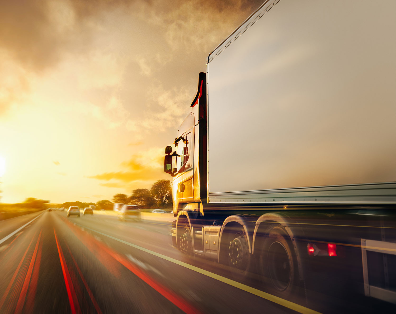 Lorry driving on the road - mass international payments. RationalFX help your business with global payments with our international mass payments product.