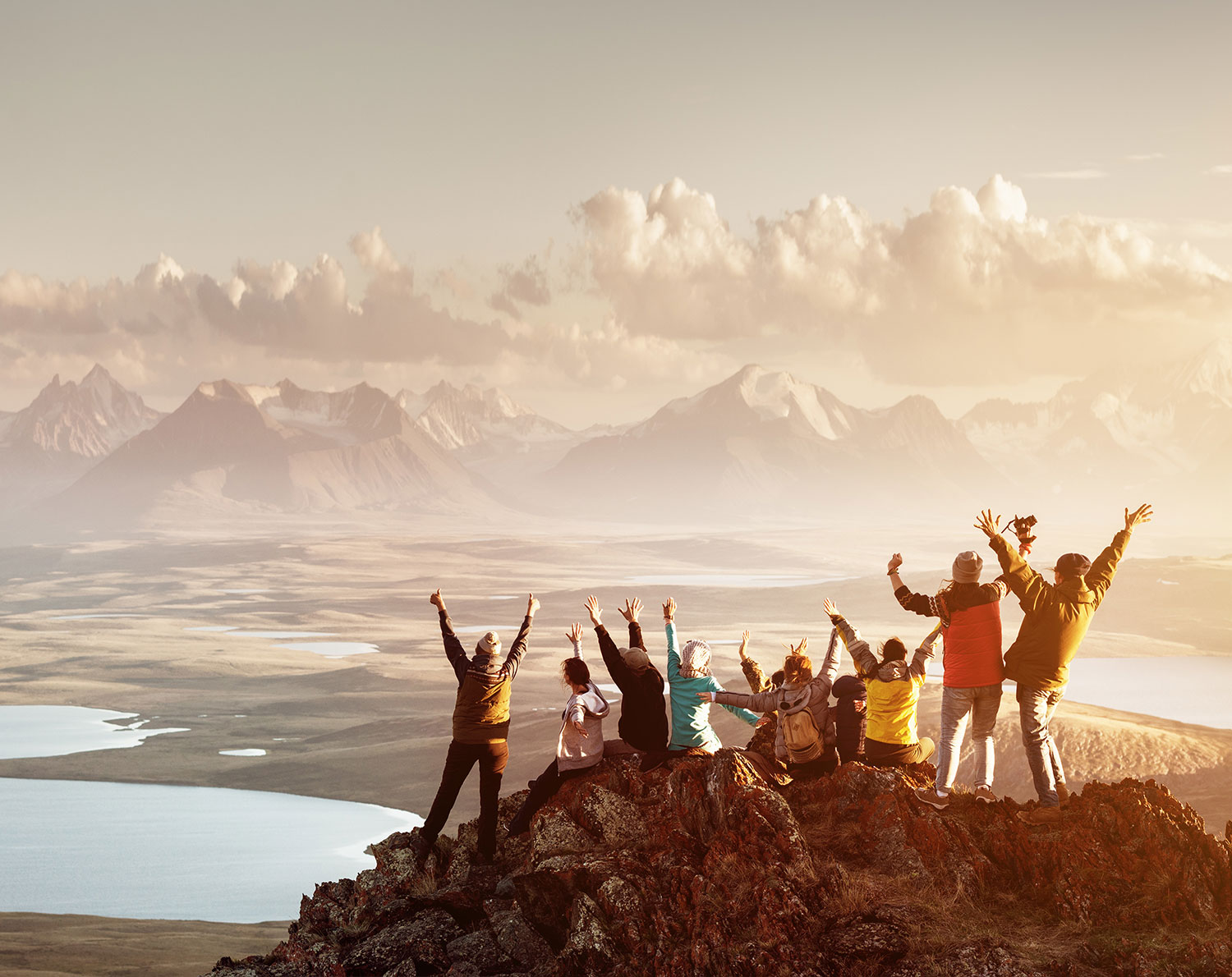 Group of people on a mountain top, overlooking hills and cheering - RationalFX Awards and Recognition received for contribution to the foreign exchange industry