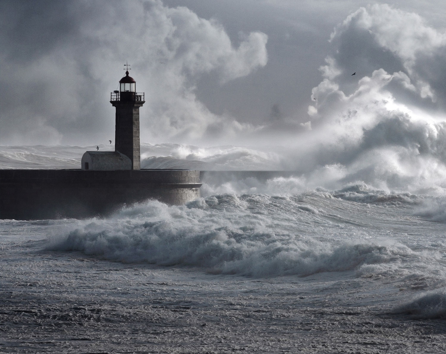 Grey scale light house next to ocean with crashing waves - RationalFX Security and regulations