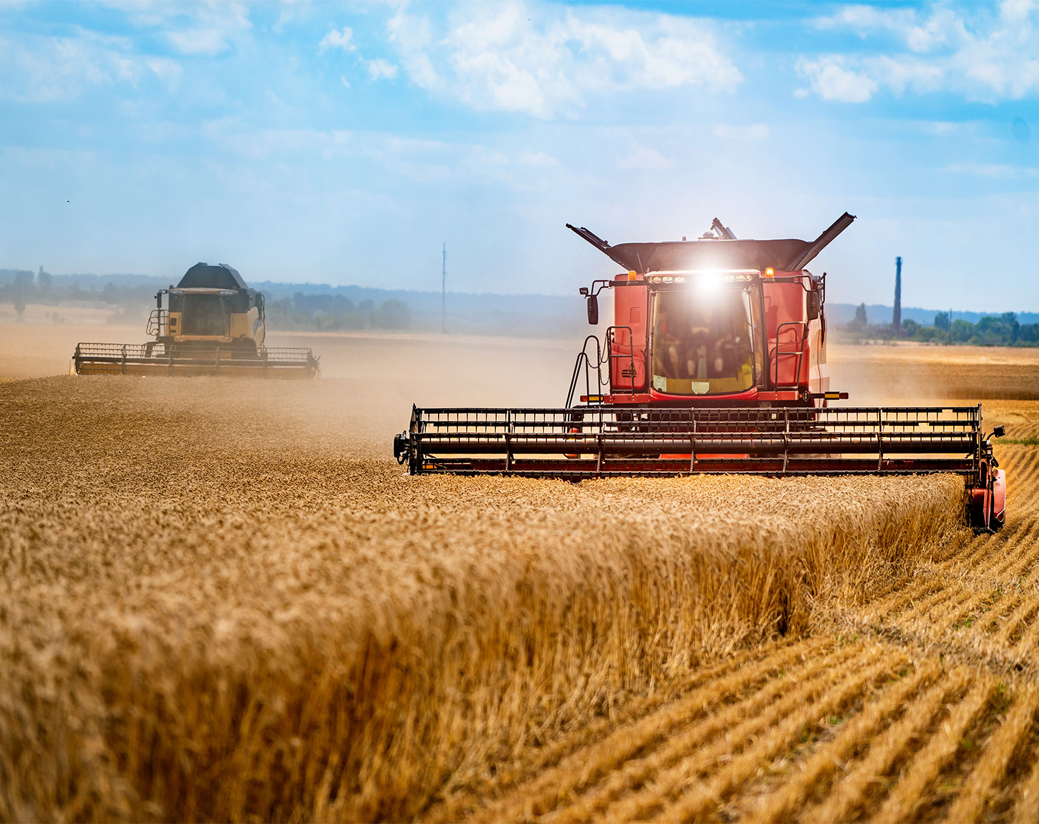 Tractor driving amongst wheat field - FX products for business. Whether it's a FX spot contract a foreign currency forward contract or a tailored currency strategy, RationalFX provide all the tools you need for cost-effective and convenient business fx payments and transfers.