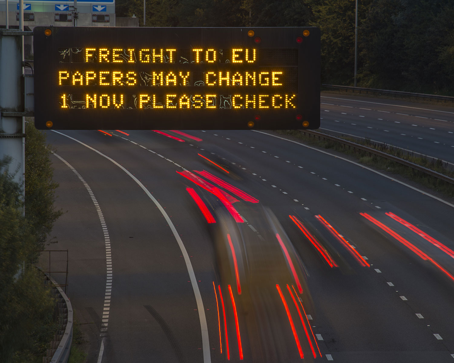 Brexit Freight UK Motorway Signage With Blurred Vehicles