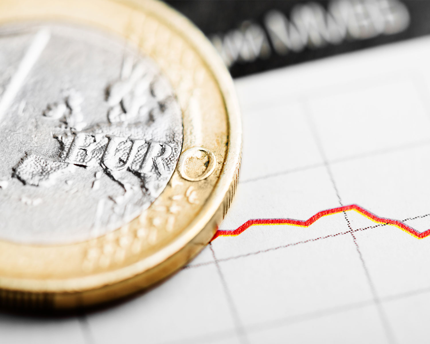 One euro coin on fluctuating graph