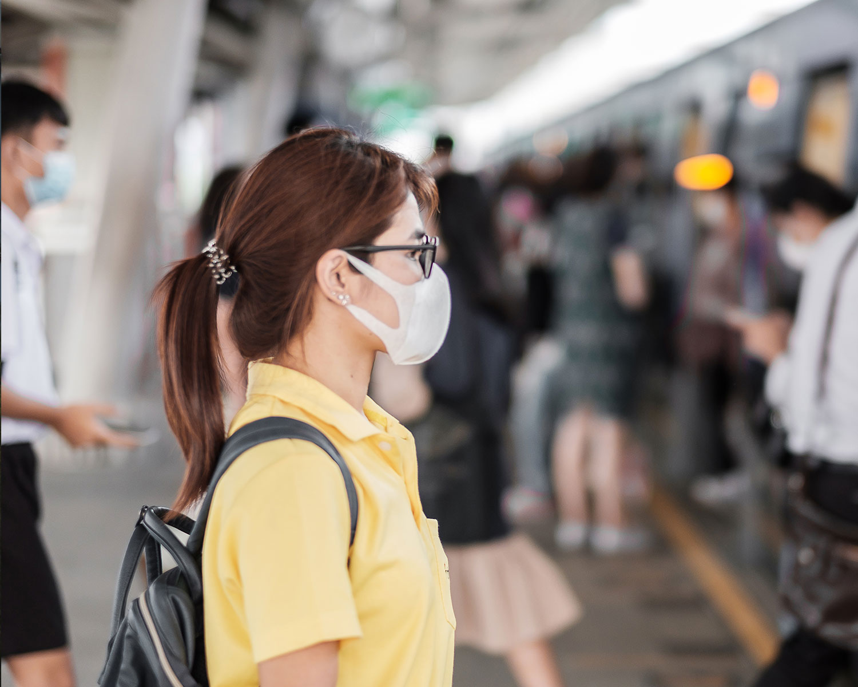 young Asian woman wearing protection mask against Novel coronavirus
